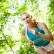 Woman Running Outdoors in Forest — Stockfoto