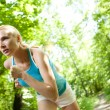 Woman Running Outdoors in Forest — Stok fotoğraf
