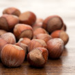 NutsNuts at wooden table — Stock Photo
