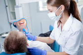 Young female dentist working in her office. — Stock Photo