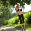 Running woman in park - Stock Photo