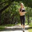 Running woman in park — Stock Photo #11463380