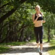 Stock Photo: Running woman in park