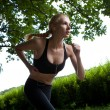 Running woman in park - Foto de Stock