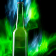 Beer bottle with color fire — Stock Photo