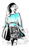 Freehand sketch of shopping girl with bag — Stock Vector