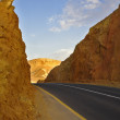 Modern highway in ancient desert — Stock Photo #11078958
