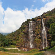 Double falls in mountains. The photo is made by a lens Fisheye — Stock Photo