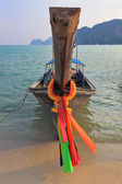 Orange Thai tourist boat moored on the beach — Stock Photo