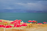 Red beach umbrellas — Stock Photo