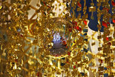 Mirror spheres and gold tinsel — Stock Photo
