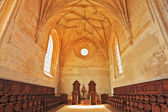 The magnificent chapel with a rows of oak chairs — Stock Photo
