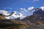 The glaciers and the snow slopes shined by the sun — Stock Photo