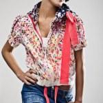 Beautiful young brunette female with bright fashion multicolored make-up. Studio photo. — Stock Photo