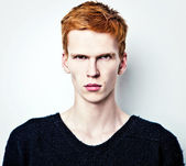 Young red haired man on light background. — Stock Photo