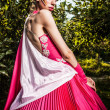 Attractive romantic woman on beautiful dress pose outdoor. - ストック写真