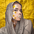 Fashion Beautiful Woman over grunge yellow background. — Stock Photo