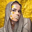 Fashion Beautiful Womover grunge yellow background. — Stock Photo #11905012