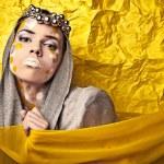 Fashion Beautiful Woman over grunge yellow background. — Stock Photo #11905471