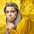 Fashion Beautiful Woman over grunge yellow background. — Stok fotoğraf