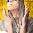 Fashion Beautiful Woman over grunge yellow background. — Stock fotografie