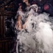 Fine art photo of a young fashion lady in a dark mystic location. - Stock Photo