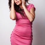 Perfect woman on pink dress. — Stock Photo #11907955