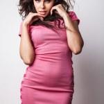 Perfect woman on pink dress. — Stock Photo #11907975