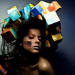 Fashion close-up portrait of beautiful young girl with cubes on head. Conceptual photo. — Stock Photo #11910547