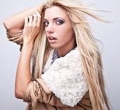 Amazing studio portrait of beautiful young blond woman. — Stock Photo