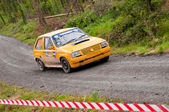 P. Dohney driving Opel Corsa — Stock Photo