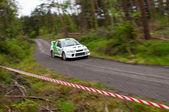 J. Laverty driving Mitsubishi Evo — Stock Photo