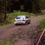 Постер, плакат: C Britton driving Subaru Impreza