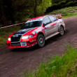S. Wright driving Mitsubishi Evo — Stock Photo