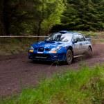 Постер, плакат: M Cairns driving Subaru Impreza
