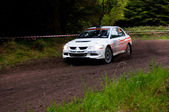 G. Lucey driving Mitsubishi Evo — Stock Photo