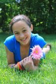 Pretty girl holding a flower — Stock Photo