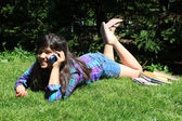 Young girl talking on cellphone — Stock Photo