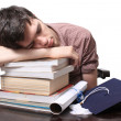 Graduate sleeping on books — Stock Photo