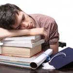 Graduate sleeping on books — Stock Photo #11395477