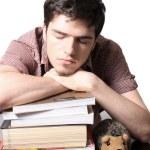 Teen male sleeping on books — Stock Photo #11395478