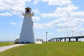 Confederation Bridge and lighthouse — Stock Photo