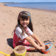 Little girl at the beach in P.E.I — Stock Photo #11658711
