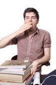 Tired male teen yawning — Stock Photo