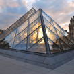 Paris. Glass pyramids at sunset — Stock Photo