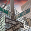 Street signs indicating Roads intersection — Stock Photo