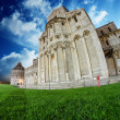 Fisheye view of Cathedral and Baptistery in Piazza dei Miracoli, — Stock Photo