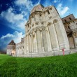 Fisheye view of Cathedral and Baptistery in Piazza dei Miracoli, — Stock Photo #10750090