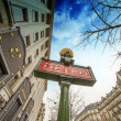 Metro Sign in Paris with Architecture in background - Foto de Stock  