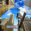 New York City - Manhattan Skyscrapers and Street Signs — Stock Photo